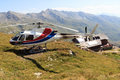 Transport helicopter landed near alpine hut and mountain panorama, Hohe Tauern Alps, Austria