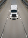 Transport truck on highway a lone white in the middle lane of a as seen from a bridge above Royalty Free Stock Image