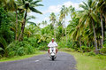 Transportation in aitutaki cook islands sep tourist man drives hired motorbike on sep it s one of the must popular activity the Royalty Free Stock Image