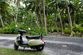 Transportation in aitutaki cook islands sep tourist woman explore the nature with motorbike on sep it s one of the must popular Stock Image