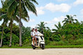 Transportation in aitutaki cook islands sep tourists travel by motorbike on sep it s one of the must popular activity the island Royalty Free Stock Photos