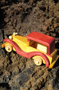 Transportation concept wooden toy car on the rocks Stock Photos