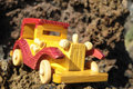 Transportation concept wooden toy car on the rocks Stock Image