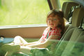 Transportation little girl child kid sitting in the car road eyeglasses back of and going on a trip travel Royalty Free Stock Image