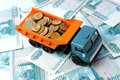 Transportation money of small coins for the toy truck concept Stock Image