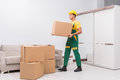 The transportation worker delivering boxes to house Royalty Free Stock Photo
