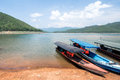 Transporting boat parking at strand in mae ngat dam chiang mai thailand Royalty Free Stock Photo
