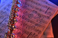 Transverse flute and old sheet music red blue illuminated elevat Royalty Free Stock Photo