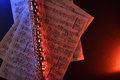 Transverse flute and old sheet music red blue illuminated top Royalty Free Stock Photo