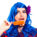 Transvestite man with ice pop Stock Image