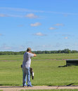 Trap shooting a young shooter and hitting a clay pigeon Stock Images