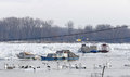 Trapped boats into the frozen Danube river