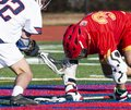 Trapping the ball during lacrosse face off