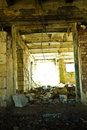 Trash in abandoned cow barn Royalty Free Stock Photo