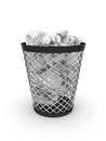 Trash bin with crumpled paper Royalty Free Stock Photography