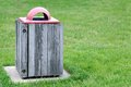 Trash bin on grass in campus Stock Photography