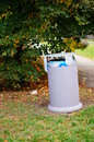 Trash bin gray standing at a park Royalty Free Stock Image