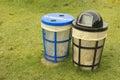 Trash bins in grassy park