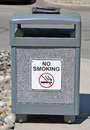 Trash can a public with a no smoking sign on it Royalty Free Stock Image