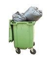 Trash can surrounded by a bunch of garbage bags isolated on whit Royalty Free Stock Photo