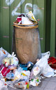 Trashcan with lots of garbage photo a Royalty Free Stock Image