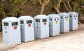 Trashcan six recycle bins in forest to the public Royalty Free Stock Images