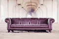 Trashed sofa under overpass Royalty Free Stock Photo