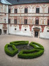 Tratzberg castle courtyard with cropped bushes Stock Images