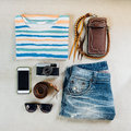 Travel accessories. Sweaters, jeans, cellphone, belts, wallets, Royalty Free Stock Photo