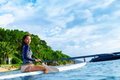Travel Adventure. Woman Paddling On Surfing Board. Royalty Free Stock Photo