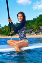 Travel Adventure. Woman Paddling On Surfing Board. Recreation, W Royalty Free Stock Photo