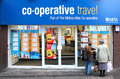 Travel agents shop front co operative is an abta and atol approved uk store with people browsing holidays vacations wolverhampton Stock Photos