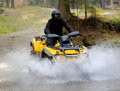 Travel on atvs in river Stock Image
