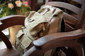 Travel bag on a chair in a restaurant Royalty Free Stock Photography