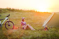 Travel with bicycle alone - young woman in the tent Royalty Free Stock Photo