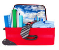 Travel blue business suitcase packed for trip Stock Image