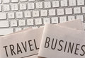 Travel and Business Newspaper on Keyboard Royalty Free Stock Photo