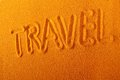 Travel close up background of yellow sand text Stock Image