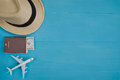 Travel Concept : Flat lay of straw hat, passport with money, pla