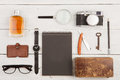 travel concept - set of cool stuff with camera and other things on wooden table Royalty Free Stock Photo