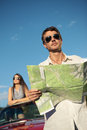 Travel destination handsome men holding a roadmap and looking away Stock Image
