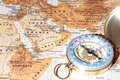 Travel destination saudi arabia ancient map with vintage compass on a pointing at planning a Stock Photos