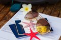 Travel documents with sun glasses flower and starfish Stock Photo