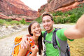 Travel hiking selfie by happy couple on hike self portrait photo active lifestyle with hikers friends or lovers smiling at camera Royalty Free Stock Photography