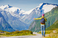 Travel hitchhiker woman walking on road during holiday travel Royalty Free Stock Photo
