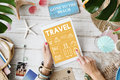 Travel icons on tablet messy table Royalty Free Stock Photo