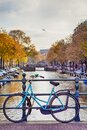 Travel Ideas. City of Amsterdam. Traditional Dutch Bicycle In Front of The Canal Fence in Amsterdam Royalty Free Stock Photo