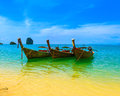 Travel landscape beach with blue water and sky at summer thailand nature beautiful island and traditional wooden boat scenery Royalty Free Stock Photo