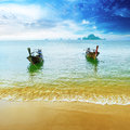 Travel landscape beach blue water sky summer thailand nature beautiful island traditional wooden boat scenery tropical paradise Royalty Free Stock Photo