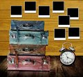 Travel memories concept retro luggage with photo frame on wooden wall Royalty Free Stock Image